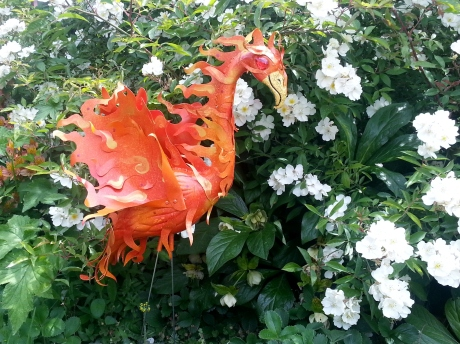 This is the phoenix in my garden. The artist made it out of an old pink flamingo. This is a good kind of orange, the orange of transformation.